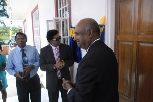 Attorney General and Minister of Legal Affairs Anil Nandlall reads the plaque on the Mediation Centre.  Chancellor of the Judiciary (ag) Justice Carl Singh, is also in photo