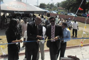 Attorney General and Minister of Legal Affairs Anil Nandlall assists  Chancellor of the Judiciary (ag) Justice Carl Singh to cut the ribbon to commission the Mediation Centre in Berbice