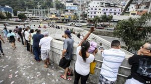 Voters queue in Rocinha, which saw brisk polling