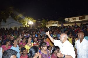 President Donald Ramotar greeting the crowd at Uitvlugt Community Centre ground during Diwali motorcade. [GINA Photo]