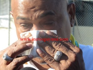 Glenn Lall breaks down in tears while speaking to reporters, today, Monday, October 27.