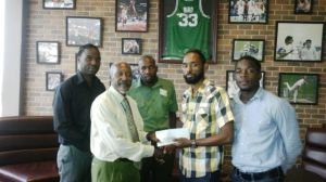 Dustanni Barrow hands over cheque to Terry Grant (second from left)
