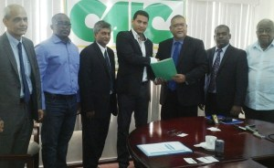 Alex Madeleine, second Vice-President of the Chamber of Commerce Industry of French Guiana [third from left] and Member of CIAC, Ramesh Dookhoo along with President of the PSC, Ramesh Persaud [second from right]  (iNews' Photo]