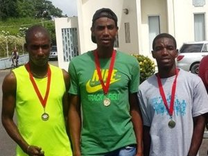 Caption Lionel D' Andrade (middle) and Kelvin Johnson (right) with their medals.
