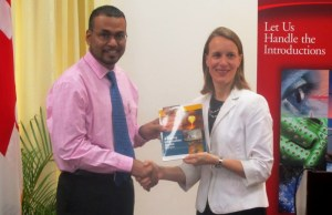 Minister of Natural Resources and Environment, Robert Persaud receives a revised version of the Mining Information Toolkit from Canadian High Commissioner, Dr Nicole Giles. [iNews' Photo]