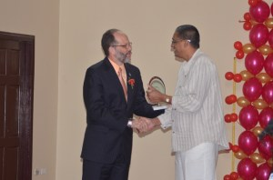 CARICOM Secretary General, Irwin Le Rocque presenting the award for longstanding contribution to the agro processing sector, to Mr. Ramsey Ally of Sterling Products Limited.