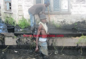 Some of the Labourers cleaning city drains without any protective gears.