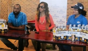 Jamaican Dancehall artiste Vanessa Saddler a.k.a Vanessa Bling (center) flanked by Project Manger of 704 Sports Bar, Dustanni Barrow (left) and Top Brandz Official. [iNews' Photo]