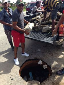 Residents of Zeeburg fill the pot hole in the area.