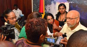 President Donald Ramotar speaks to members of the media shortly after the press conference today, Friday November 14. [Sandra Prince Photo]