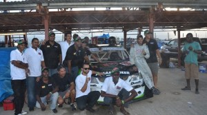 Kristian Jeffrey and his team pose after his final race. [iNews' Photo]