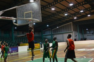 Tyrone Hamid dunks during the final minute of the game
