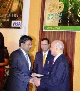 Finance Minister Dr. Ashni Singh receiving the first official Signature Visa card from Demerara Bank Chairman, Dr. Yesu Persaud.