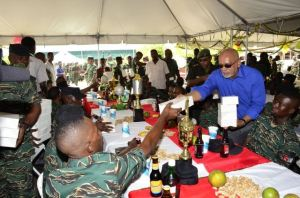 President Donald Ramotar sharing meals to junior ranks of the Guyana Defence Force at Camp Stephenson, Timehri.
