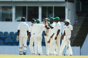 The Guyana Jaguars players celebrate another wicket.