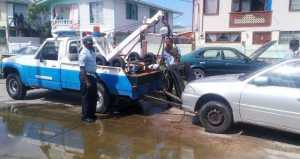 Police removing one of the stolen cars. [iNews' Photo]