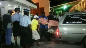 Undertakers remove the body of Stuart. [iNews' Photo]