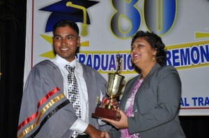 Another outstanding student receives his trophy from Minister of Education, Priya Manickchand.