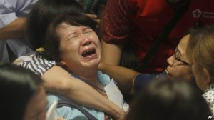 Relatives cried and hugged each other as bodies were shown on live TV