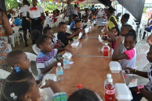 Children enjoying goodies at the party hosted by the Ministry of Human Services and Social Security