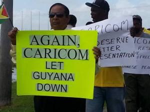 Executive Member, Moses Nagamootoo during the protest outside CARICOM