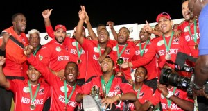 The Trinidad and Tobago players in full celebration mode after the big win against a depressing Guyana squad.