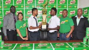 Captain of Dolphin Secondary, Shawn Mohammed (left centre) holds the winning trophy along with Captain of Chase Academy, Kareem Knights in the presence of sponsors, organizers and teachers. [iNews' Photo]