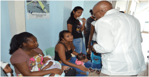 Minister Norman Whittaker during his visit to the health facility