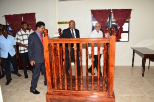 President Donald Ramotar accompanied by Attorney General, Anil Nandlall and Chancellor of the Judiciary (ag) Carl Singh tour the new magistrate's court.
