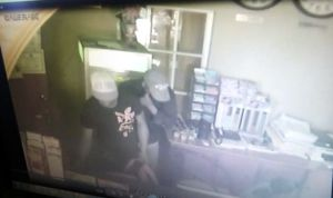 The two gunmen caught on camera executing the robbery