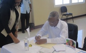 Presidential Candidate of the APNU+AFC David Granger signs the Code of Conduct. [iNews' Photo]