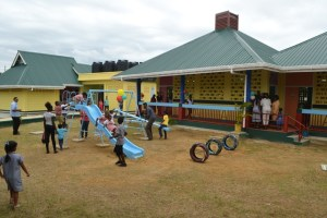 Children enjoying the play facilities in the Number 77 Village Nursery school compound