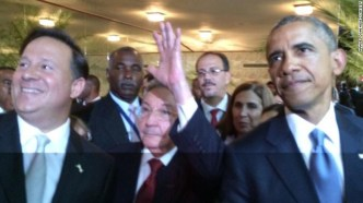 US President Barack Obama (right) and Cuban Leader, Raul Castro (center) at the Seventh Summit of the Americas.