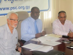 PSC Chairman Ramesh Persaud [centre] flanked by other PSC officials