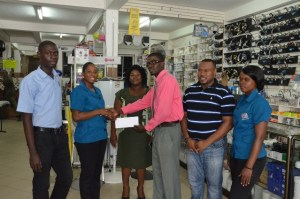 Loyette Barnwell hands over the sponsorship cheque to Petra Organization