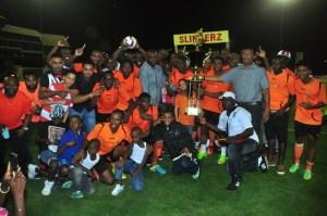 Slingerz FC celebrate their monumental victory.