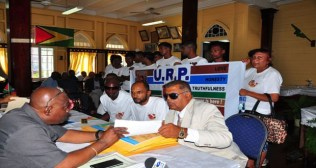 URP submitting its Lists of Candidates to GECOM