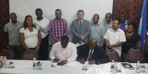 : FAO and Guyana Forestry Commission Officials signing the agreement