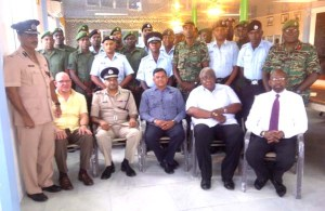 Participants of the Heavy Duty Equipment Training programme pose with Commissioner of Police Seelall Persaud, BK International officials.