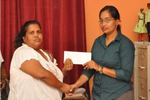 Mrs. Khublall receiving a donation from IAC Executive Member, Ms. Safiya Gafoor