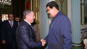 Nicolas Maduro (right) announced he had reached a deal with Rosneft CEO Igor Sechin