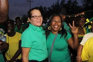Mrs Granger with an APNU+AFC supporter during the campaign trail