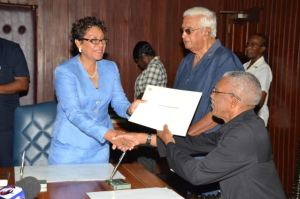 Mrs Valerie Garrido- Lowe, Minister within the Ministry of Indigenous People's Affairs being sworn in by President David A. Granger.