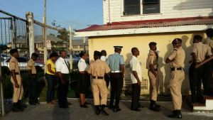 Members of the Guyana Police Force waiting their turn to vote. [iNews' Photo]