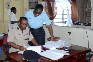 Assistant Commissioner of Police and Commander of the 'A' Division, Clifton Hicken during one of his inspections. [iNews' Photo]