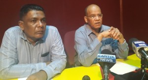 General Secretary of the PPP/C Clement Rohee (right) and Executive Secretary, Zulficar Mustapha. [iNews' Photo]