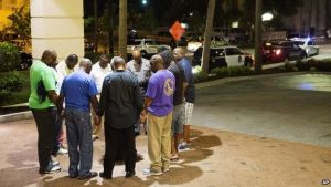A group of worshippers later gathered nearby to pray