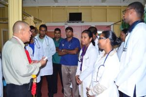 Minister of Public Health, Dr. George Norton interacting with doctors at the Suddie hospital