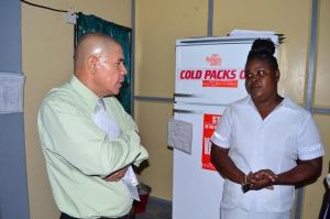 Minister of Public Health, Dr. George Norton, interacting with a staff of the National Psychiatric Hospital