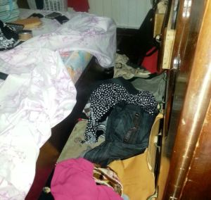 One of the ransacked bedrooms.